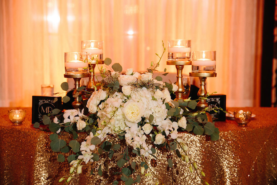 Ivory and Gold Sweetheart Table with Gold Glitter Linens with Ivory Roses and Floating Candles   St. Petersburg Wedding Venue The Don CeSar
