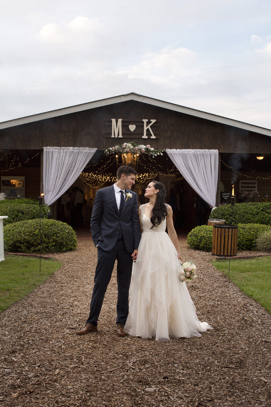 Outdoor Bride and Groom Wedding Portrait in Front of Barn | Tampa Bay Wedding Venue Cross Creek Ranch | Wedding Photographer Djamel Photography