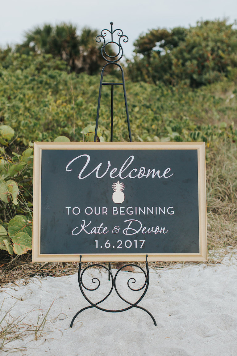 Wedding Ceremony Welcome Sign on Black Chalkboard with White Writing and Gold Pineapple Accent | Sarasota Wedding Planner Jennifer Matteo Event Planning