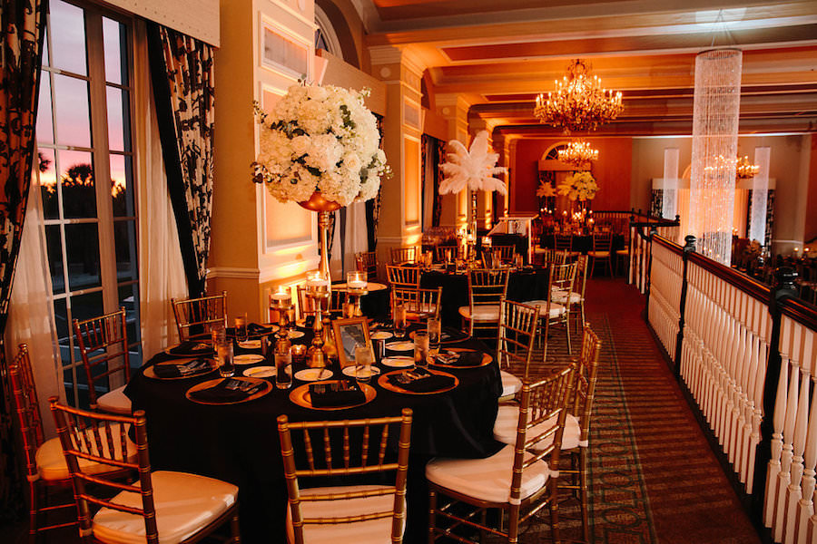 Ivory, Black and Gold Wedding Reception with Black Linens and Gold Chiavari Chairs   St. Petersburg Wedding Venue The Don CeSar   Tampa Bay Wedding Photographer Jonathan Fanning Studio and Gallery   A Chair Affair