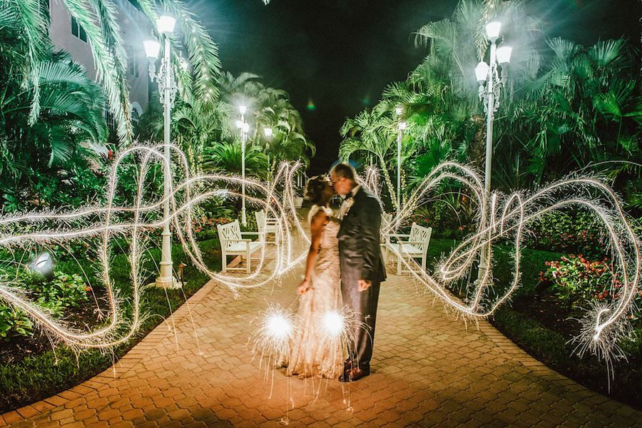 Outdoor Bride and Groom Sparkler Wedding Exit   St. Petersburg Wedding Venue The Don CeSar   Tampa Bay Wedding Photographer Jonathan Fanning Studio and Gallery