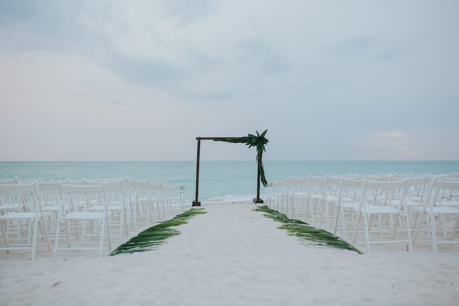 Outdoor Sarasota Wedding Ceremony with Palm Lined Aisle and Wooden Arch | Sarasota Wedding Planner Jennifer Matteo Event Planning