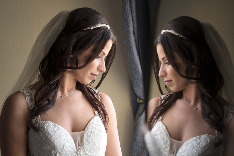 Getting Ready: Bride in Ivory Beaded Gown With Veil Looking in Mirror Wedding Portrait | Tampa Bay Wedding Photographer Marc Edwards Photographs
