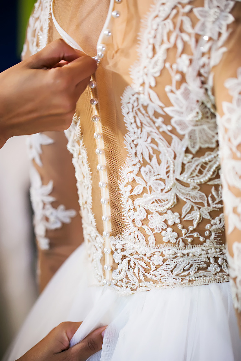 Bride Getting Dressed   Nude Illusion Lace Wedding Dress with Sleeves   Tampa Bay Bridal Shop Isabel O'Neil Bridal   Wedding Photographer Limelight Photography