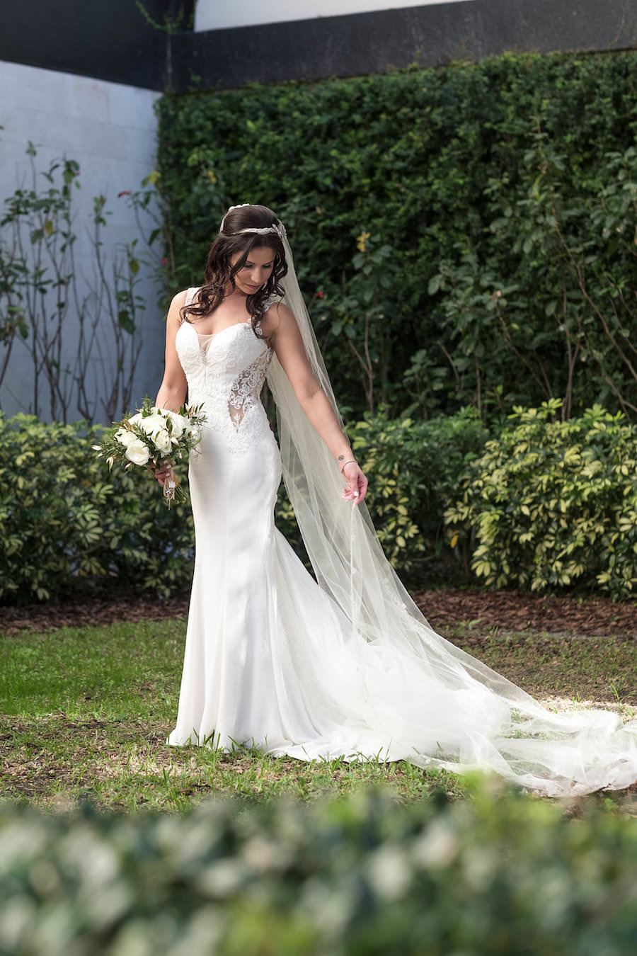 Outdoor Bride with Ivory Gown and Veil with Lace Details and Ivory Roses Wedding Portrait | Tampa Wedding Photographer Marc Edwards Photographs | Florist Apple Blossoms Floral Designs