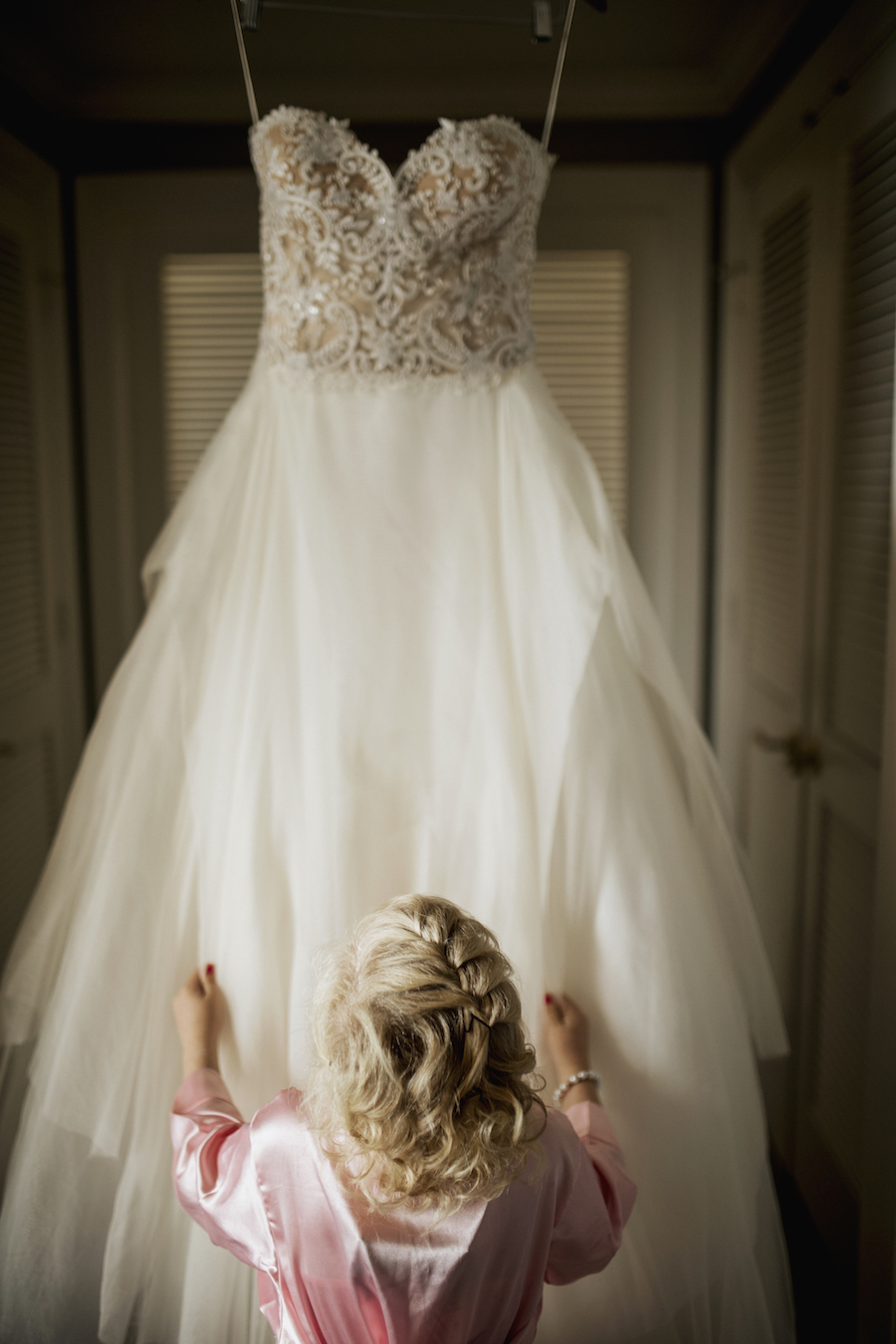 Flower Girl in Pink Robe Looking Up at Ivory Lace and Tulle Reem Acra Ballgown Wedding Portrait   Getting Ready Suite at Ritz Carlton Sarasota   Tampa Bay Wedding Planner NK Productions