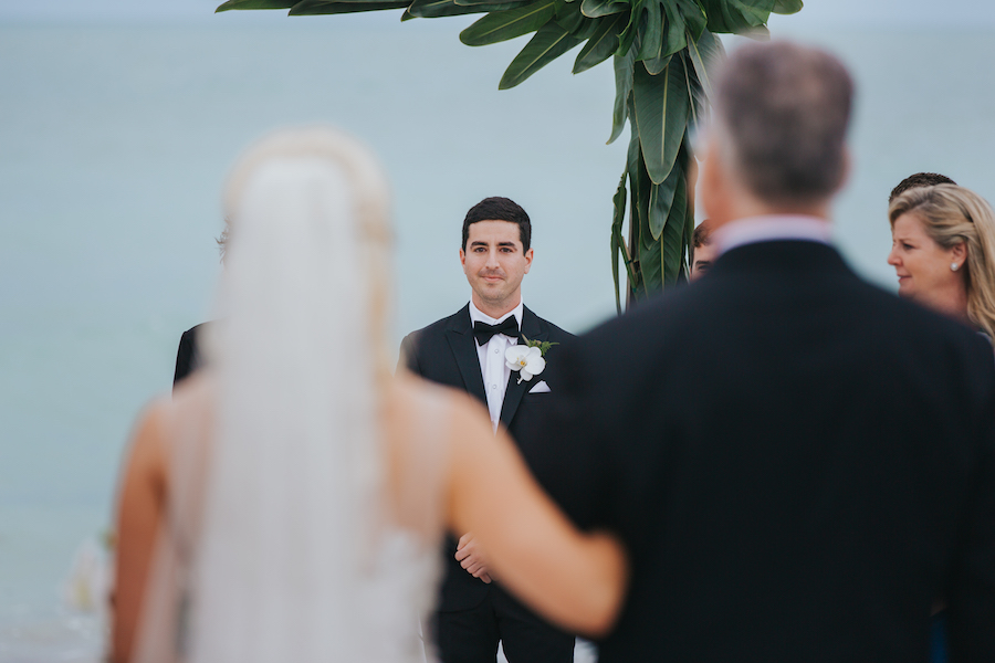 Outdoor Sarasota Wedding Ceremony Groom Looking at Bride Walking Down Aisle