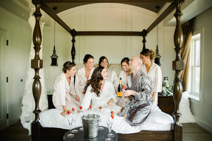 Getting Ready Bride and Bridesmaids Drinking Champagne | St. Petersburg Wedding Venue The Birchwood | Tampa Bay Wedding Photographer Ailyn La Torre Photography