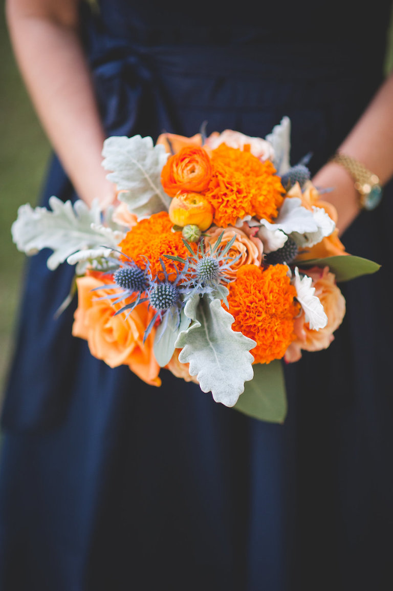 Fall Inspired Bridesmaids Wedding Bouquet with Orange Flowers and Greenery | Navy Blue Bridesmaids Dress with Bouquet