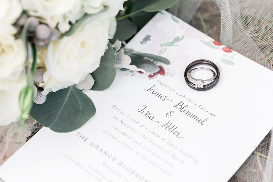 White Floral Garden Invitation with Black Wedding Groom's Wedding Band and Round Cut Diamond Engagement Ring