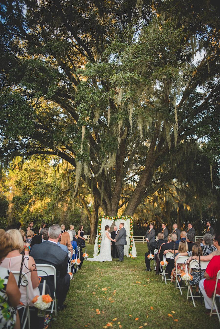 Outdoor Dade City Bride and Groom Wedding Ceremony Portrait | Rustic Dade City Wedding Venue | Outdoor Rustic Tampa Bay Wedding Ceremony with Large Oak Trees | The Lange Farm