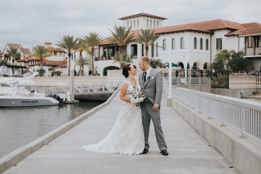 Bride and Groom Waterfront Wedding Portrait | South Tampa Wedding Venue Westshore Yacht Club | Tampa Bay Wedding Videographer Bonnie Newman Creative | Tampa Bay Wedding Florist Wonderland Floral Art