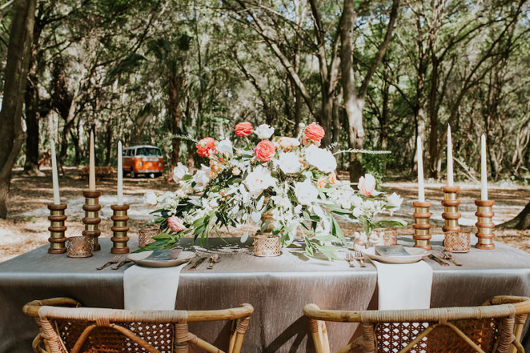 Peach and Blush Pink Wedding Centerpieces with Greenery, Candles and Wicker Chairs | Retro Vintage Boho Wedding Inspiration | Tampa Wedding Florist Northside Florist | Planner Glitz Events | Outdoor Venue Casa Lantana