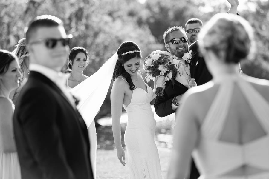Black and White Bride and Groom Candid Wedding Portrait Celebrating After Ceremony   Tampa Bay Wedding Videographer Hatfield Productions