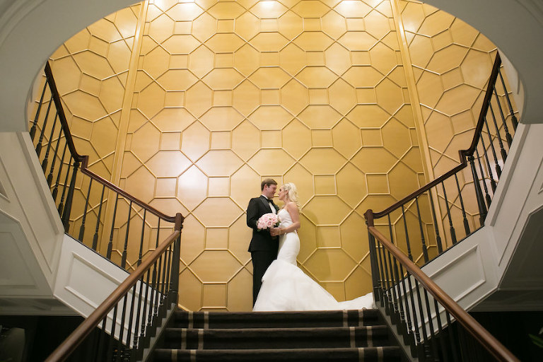 Bride and Groom Wedding Portrait on Staircase with Pink Bridal Bouquet | Wedding Venue The Tampa Club | Tampa Bay Wedding Photographer Carrie Wildes Photography | Wedding Florist Northside Florist