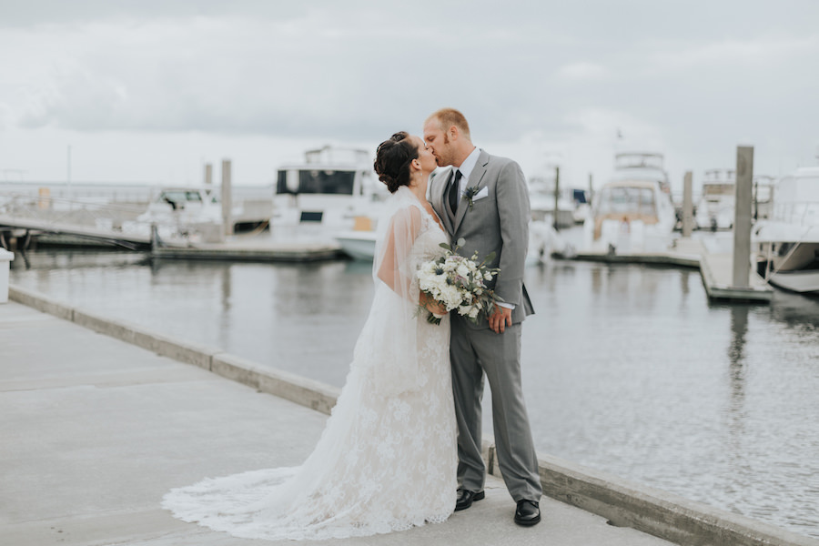 Bride and Groom Waterfront Wedding Portrait | South Tampa Wedding Venue Westshore Yacht Club | Tampa Bay Wedding Videographer Bonnie Newman Creative | Tampa Bay Wedding Florist Wonderland Floral Art