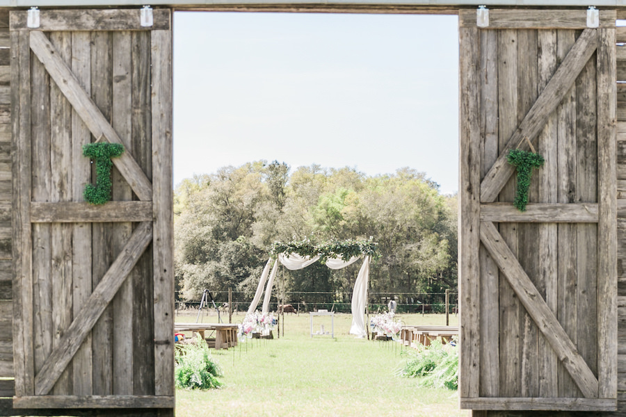 Barn Doors with Draped Wedding Altar with Greenery   Outdoor Wedding Ceremony at Tampa Bay Wedding Venue Orange Blossom Barn     Rustic, Country Wedding Inspiration