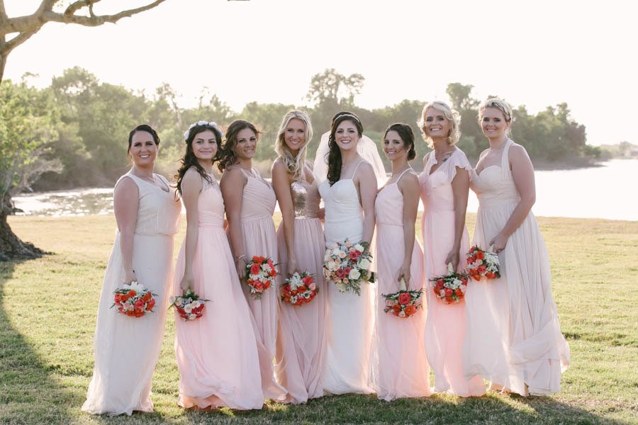 Bride in Ivory Gown with Bridesmaid in Blush Pink Bridesmaid Dresses Wedding Portrait   Tampa Bay Wedding Videographer Hatfield Productions