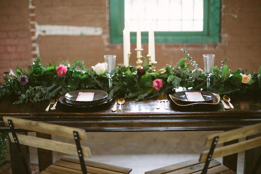 Florida, Modern Bohemian Inspired Styled Shoot | Vintaged Wooden Sweetheart Table with Folding Chairs and Greenery Garland Decor and Gold Flatware and Charger Plates | Tampa Bay Wedding Planner Glitz Events