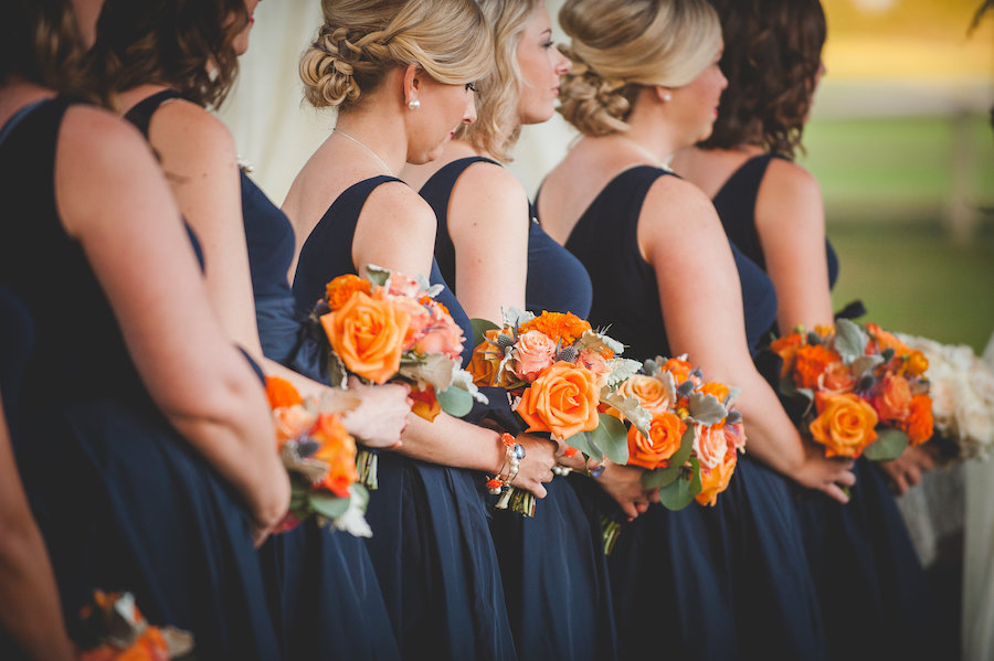 Navy Blue Bridesmaids Bridal Party Wedding Ceremony Portrait | Short Navy Blue Bloomingdale's Bridesmaids Dresses with Pearls and Bright Orange and Green Bouquets | Dade CIty Wedding Venue The Lange Farm