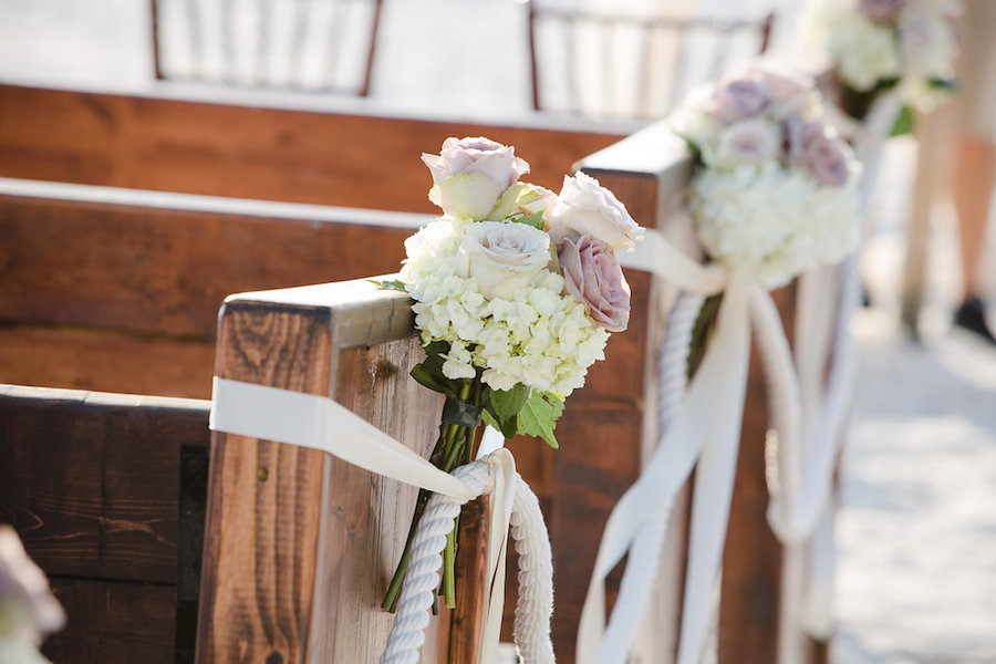 White and Blush Pink Dusty Rose Wedding Ceremony Floral Arrangement with White Ivory Hydrangeas with Greenery with Wooden Church Pews | Clearwater Beach Wedding Planner Parties a la Carte