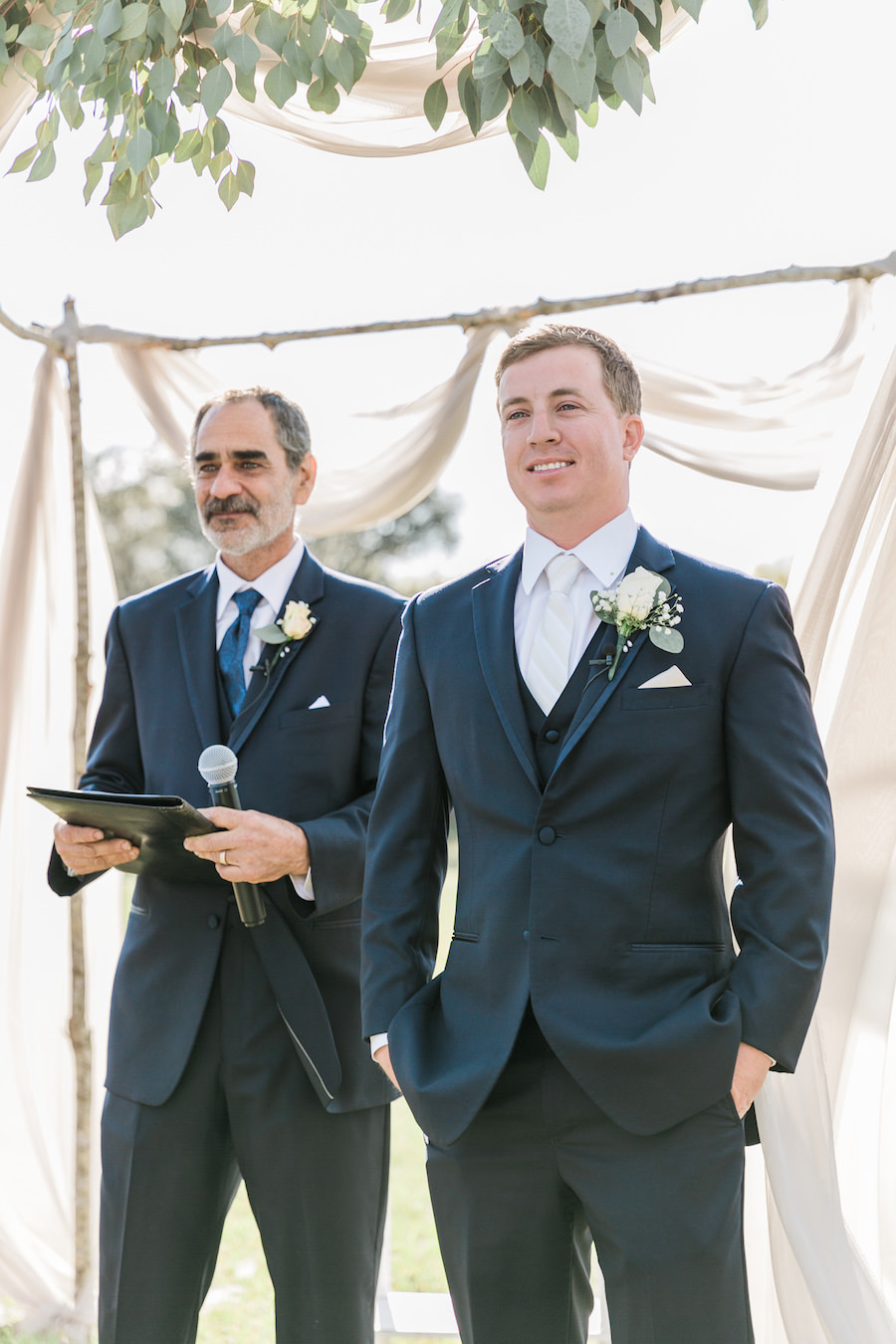 Groom's Reaction Wedding Portrait to Watching Bride Walk Down the Aisle