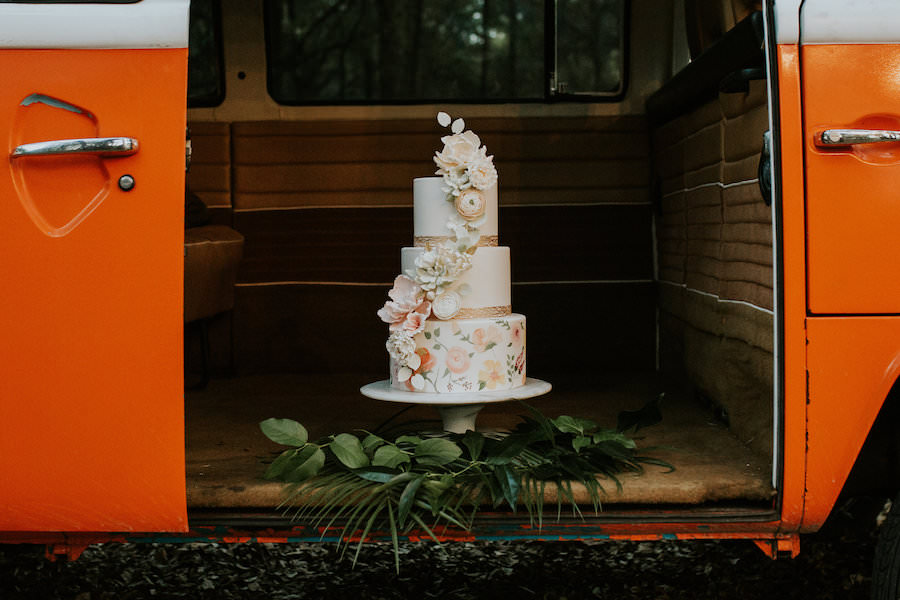 3-Tier Round Hand Painted Wedding Cake with Cascading Sugar Flowers and Gold Leaf Boarder   Retro Vintage Boho Wedding Inspiration with Orange VW Bus   Tampa Wedding Cake Bakery Hands on Sweets