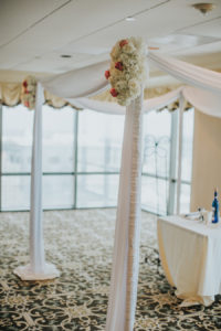 White Draped Ceremony Altar with Elegant Flowers and Decor | Downtown Tampa Wedding Venue The Tampa Club