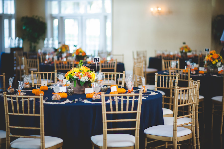 Dade City Rustic Fall Inspired Wedding Reception with Pumpkin Decor, Gold Chiavari Chairs and Navy Blue Linens from Connie Duglin Specialty Linens | The Lange Farm Wedding