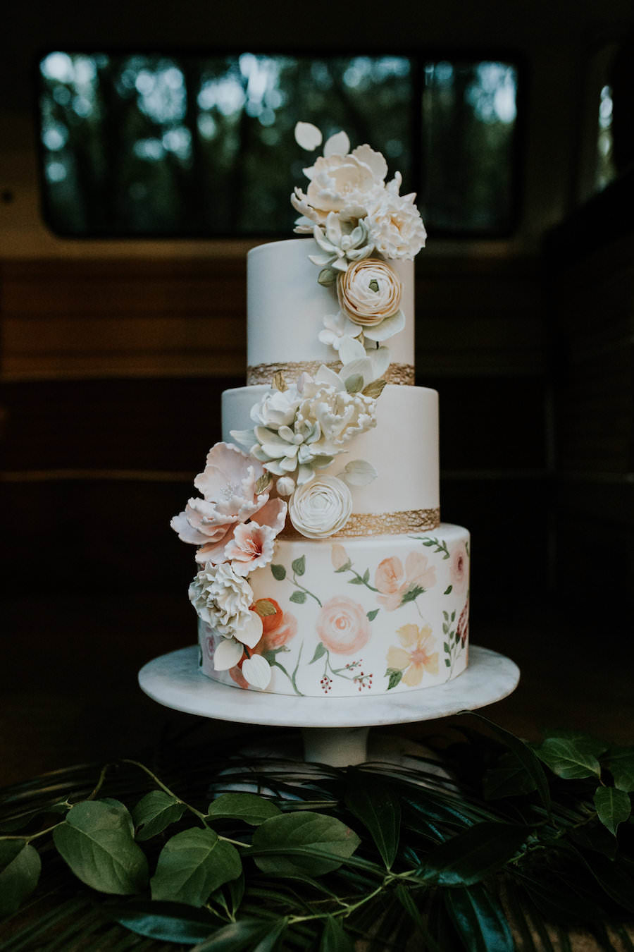 3-Tier Round Hand Painted Wedding Cake with Cascading Sugar Flowers and Gold Leaf Boarder   Retro Vintage Boho Wedding Inspiration   Tampa Wedding Cake Bakery Hands on Sweets
