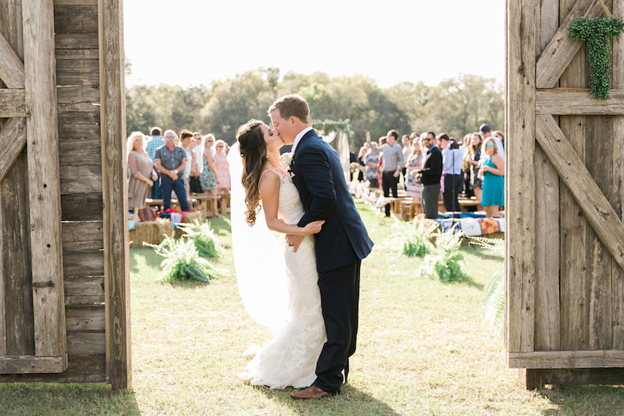 Bride and Groom Kissing after Wedding Recessional at Rustic Tampa Bay Wedding