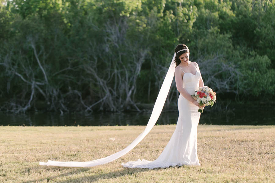 Outdoor Bridal Portrait with Ivory Lace Gown and Long Veil with Pink, Peach and Ivory Bouquet   Tampa Bay Wedding Videographer Hatfield Productions