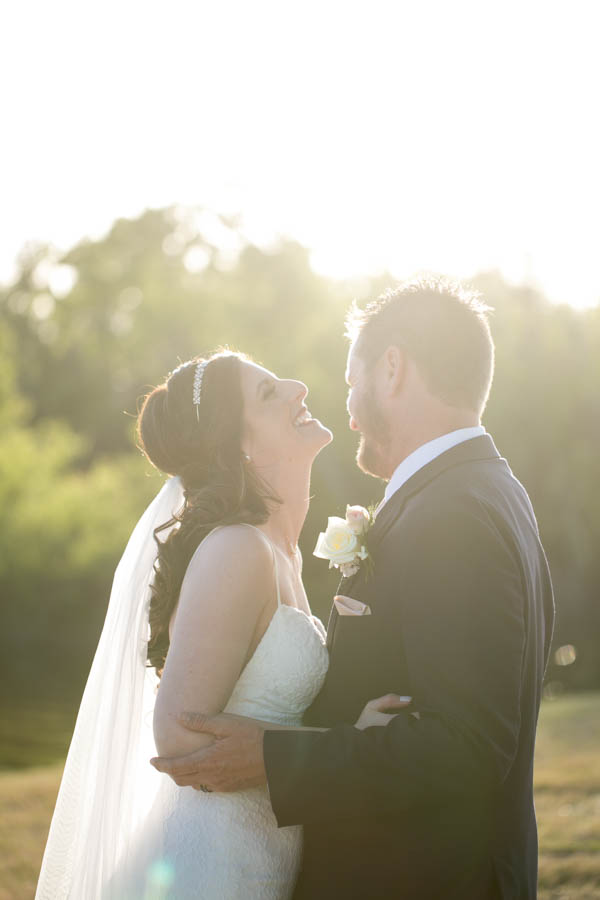 Outdoor Bride and Groom Laughing Wedding Portrait   Tampa Bay Wedding Videographer Hatfield Productions