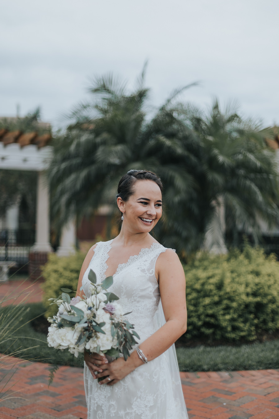 Bridal Wedding Portrait in Sleeveless Ivory Lace Wedding Dress with Ivory, Purple and Greenery Bridal Wedding Bouquet with Eucalyptus | Tampa Bay Wedding Florist Wonderland Floral Art | Tampa Bay Videographer Bonnie Newman Creative