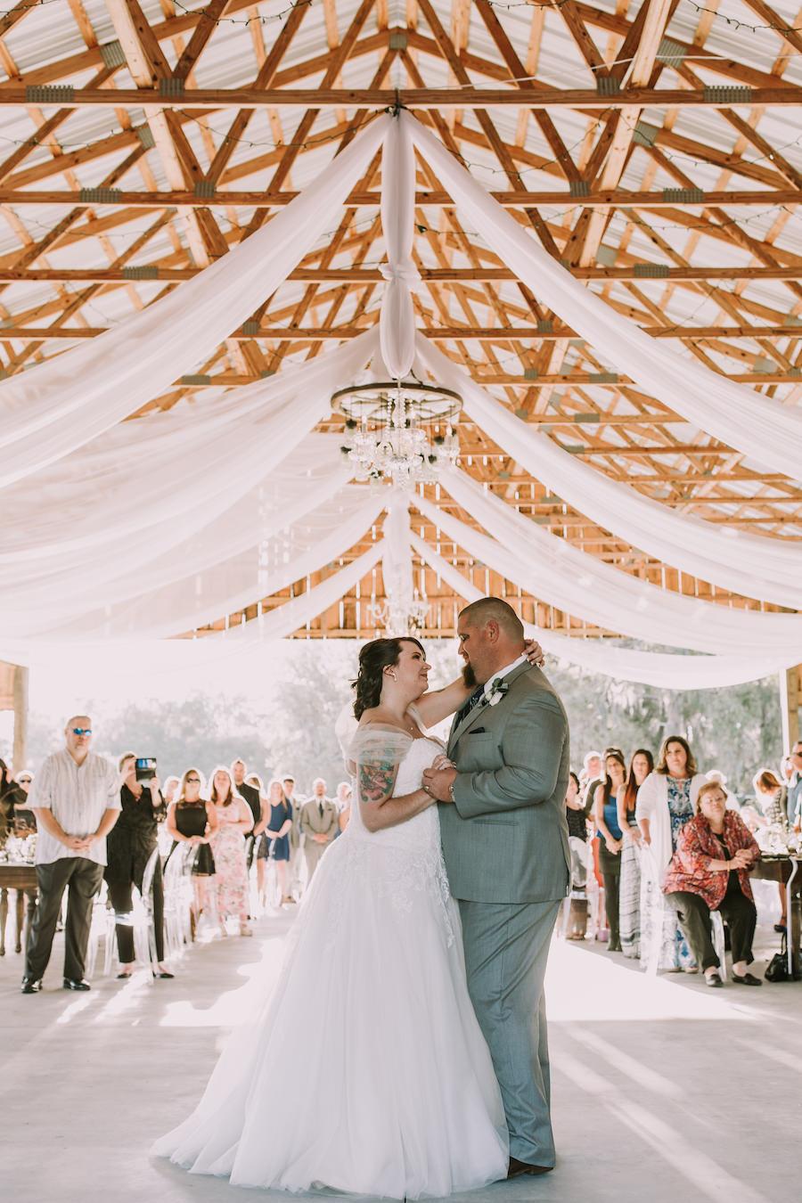 Outdoor Sarasota Barn Wedding Reception Bride and Groom First Dance Wedding Portrait | Sarasota Wedding Planner Jennifer Matteo Event Planning