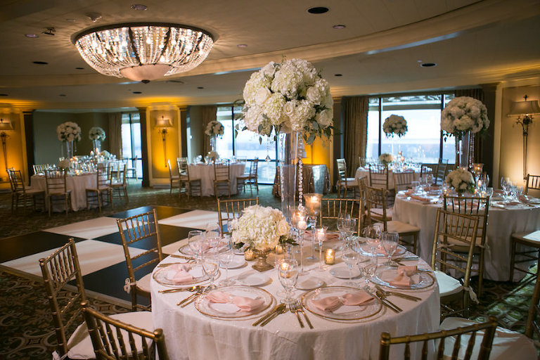 White and Gold Wedding Reception with Tall White Hydrangea Centerpieces and Gold Chiavari Chairs with White and Blush Linens | Rentals A Chair Affair | Linens by Gabro Event Services | Wedding Venue The Tampa Club | Tampa Wedding Photographer Carrie Wildes Photography | Tampa Wedding Florist Northside Florist
