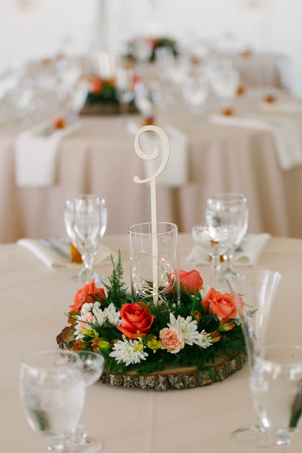 Rustic Wedding Reception Centerpieces with Ivory and Peach Floral and Tree Stump Centerpieces with Gold Table Numbers