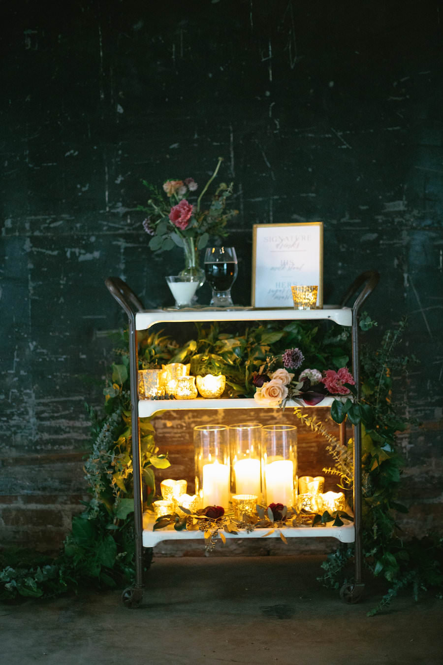 Candlelit Wedding Bar Cart with Greenery Decor and Roses | Modern Wedding Signature Drink Bar Cart with Menu | His and Her, Bride and Groom Signature Wedding Cocktails | Tampa Bay Wedding Planner Glitz Events