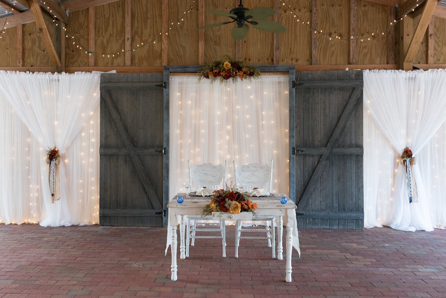 Rustic Barn Wedding Reception Sweetheart Table at Cross Creek Ranch | Tampa Bay Wedding Photographer Carrie Wildes Photography