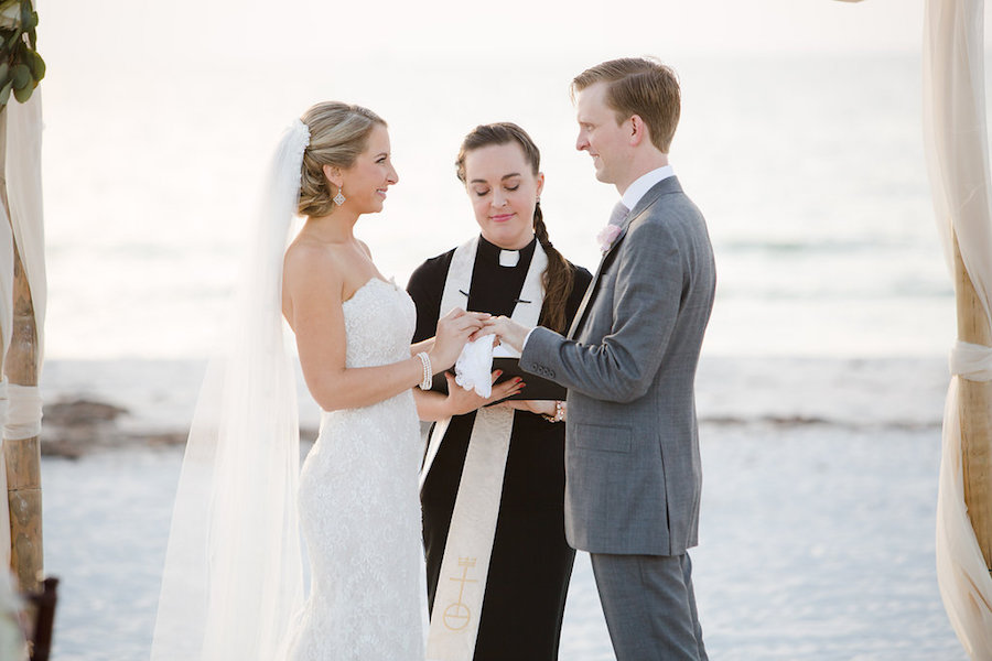 Bride and Groom at Waterfront Clearwater Beach Ceremony with Female Priest Officiant | Planner Parties a la Carte | Photographer Marc Edwards Photographs