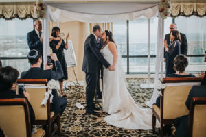 Bride and Groom Indoor Jewish Wedding Ceremony with City Skyline View | Downtown Tampa Wedding Photographer Rad Red Creative | Private Event Venue The Tampa Club