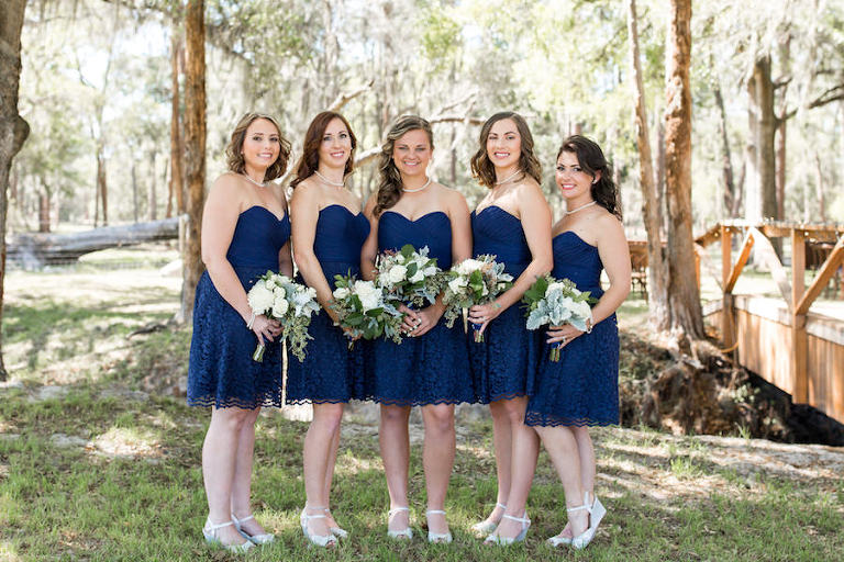 Bridesmaids Wedding Portrait in Strapless Navy, Short Lace Bridesmaids Dresses with Ivory and Greenery Bridal Bouquets