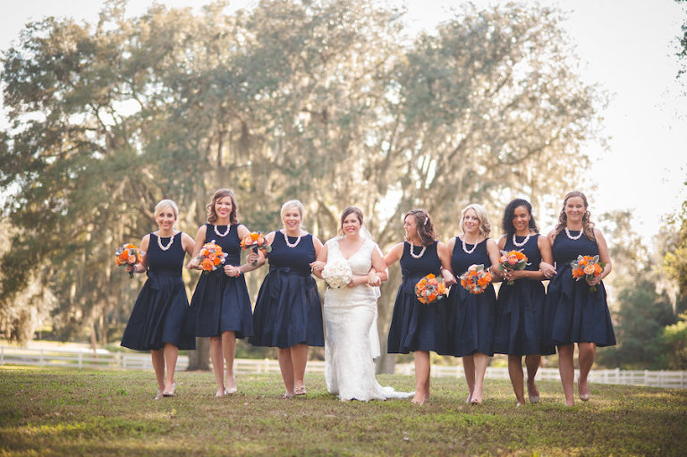 Navy Blue Bridesmaids Bridal Party Portrait with Bride | Short Navy Blue Bloomingdale's Bridesmaids Dresses with Pearls and Bright Bouquets | Dade CIty Wedding Venue The Lange Farm
