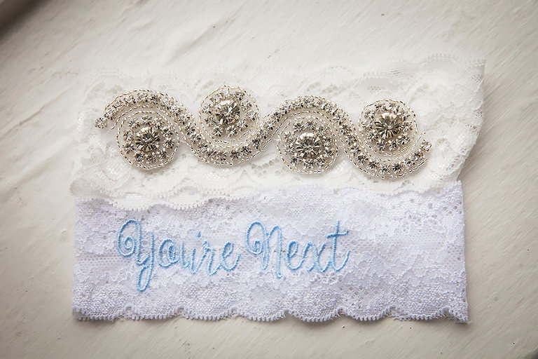 "Lace Wedding Garter With Rhinestone Detail and Light Blue ""You're Next"" Embroidery 