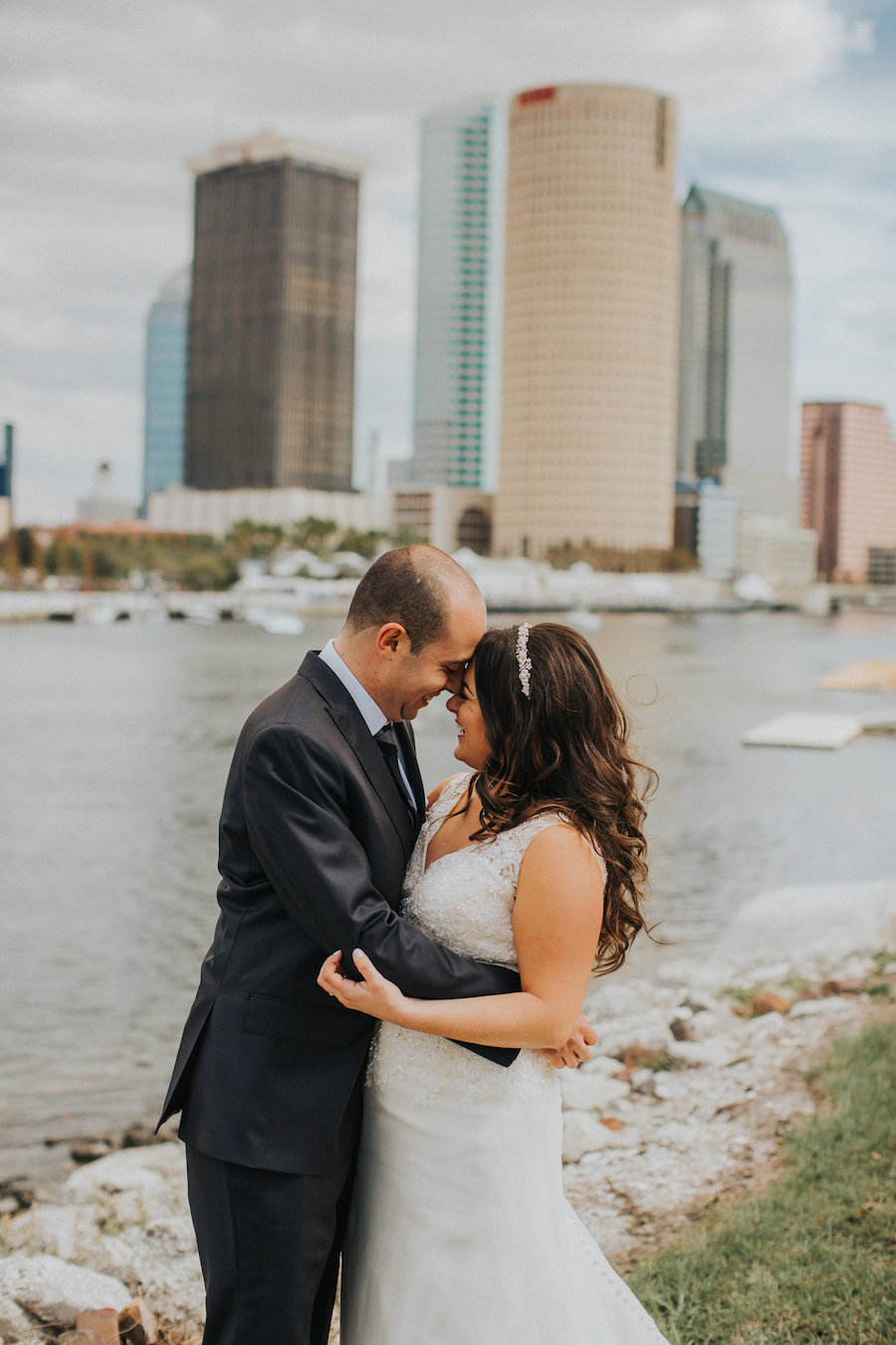 Bride and Groom Wedding Portrait with City Skyline and Waterfront View | Downtown Tampa Wedding Photographer Rad Red Creative
