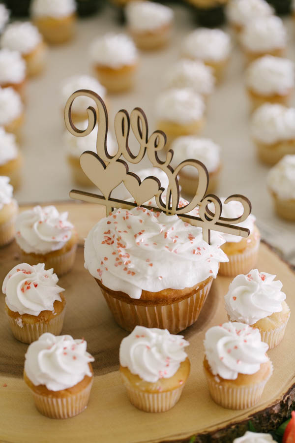 White and Pink Wedding Cupcakes with We Do Cake Topper