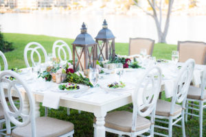 Rustic Garden Party Wedding Decor With Lantern Wedding Centerpieces   White Wooden Mismatched Wedding Reception Tables with Vintage White Wooden Chairs   Tampa Wedding Photographer Kera Photography