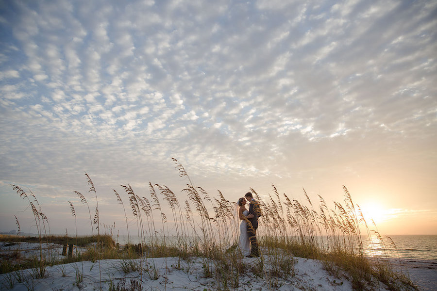 Bride and Groom Clearwater Beach Sunset Wedding Portrait in the Sand | Clearwater Beach Wedding Planner Parties a la Carte | Photographer Marc Edwards Photographs