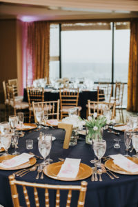 Elegant Gold Wedding Reception with Navy Blue Linens and Gold Chiavari Chairs with Gold Glitter Table Numbers | Wedding Reception Decor Inspiration and Ideas