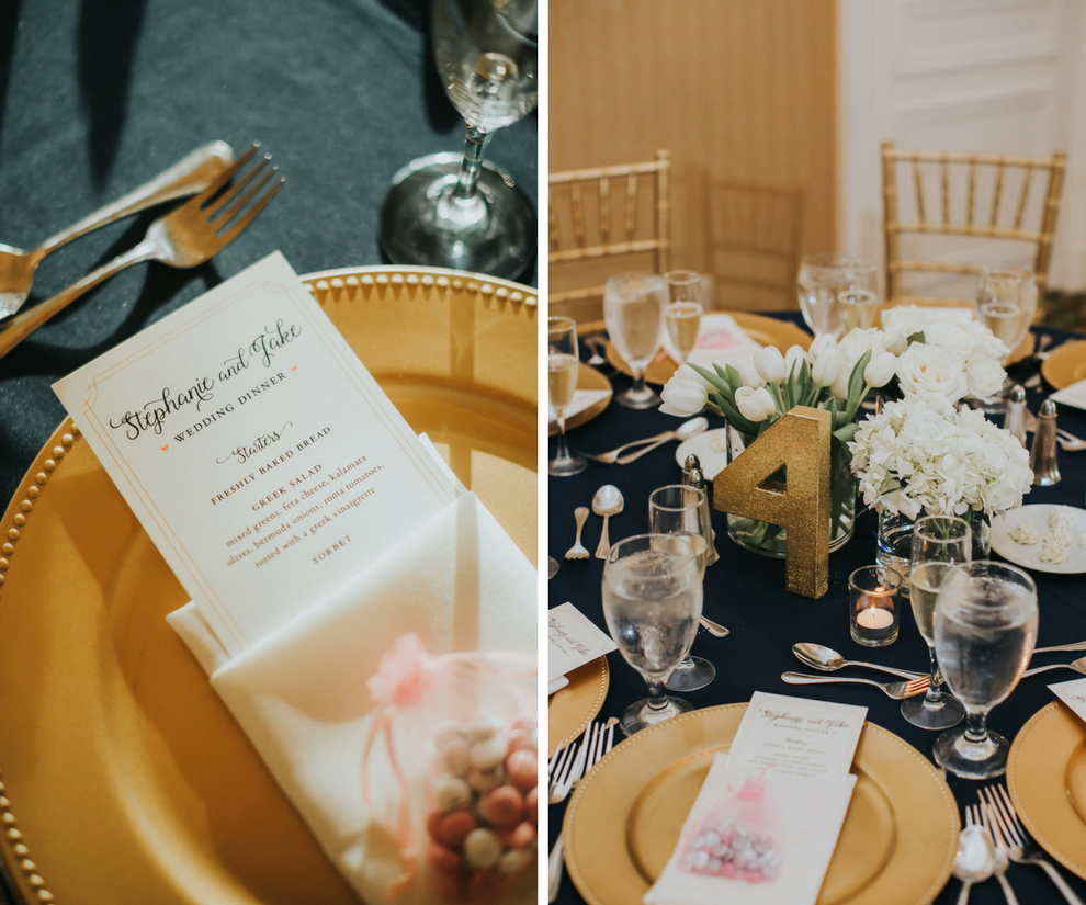 Elegant Gold Wedding Reception with Navy Blue Linens and Gold Chiavari Chairs, Beaded Charger Plates, Low White Tulip Centerpieces and Gold Glitter Table Numbers | Wedding Reception Decor Inspiration and Ideas